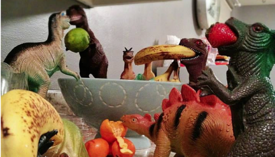 dinos had climbed onto the kitchen counter to raid the fruit bowl
